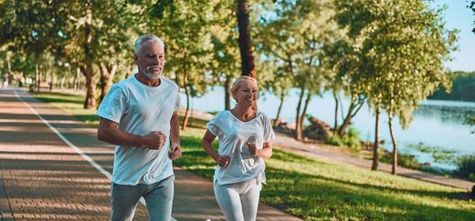 couple taking a run in a park