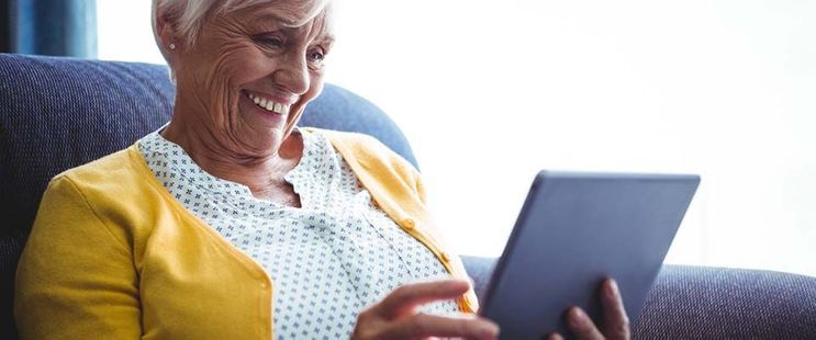 smiling lady using a tablet